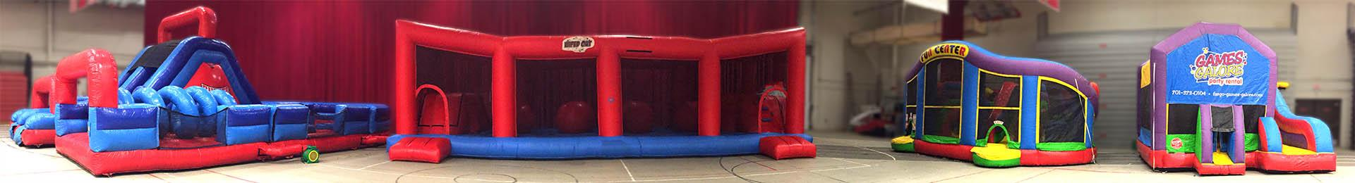 Grouping of inflatable games including the Wiped Out Interactive
